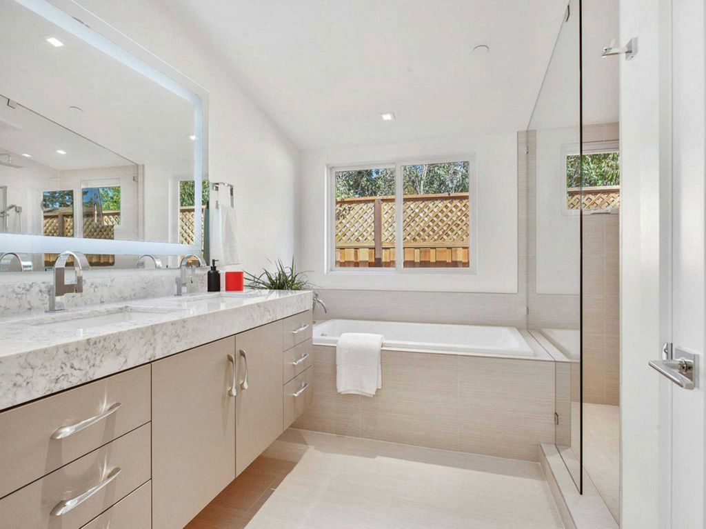 bathroom cabinet online design tool%0A Floating vanities  a soaking tub and glass shower highlight this bathroom   Photo  Open