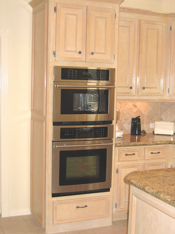 Pickled oak cabinets with granite tops undermount for Black cabinets and black appliances