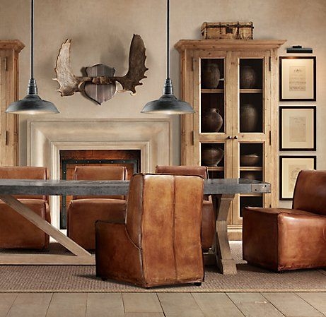 Adore The Camel Leather Chairs Against The Dark Concrete Table