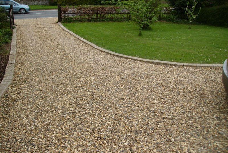 Gravel Is The Easiest And Least Expensive Option For A Driveway Front Garden Ideas Driveway Garden Ideas Driveway Driveway Ideas Cheap