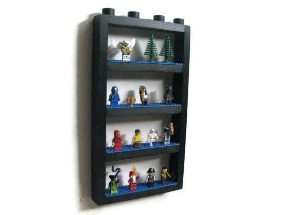 """Mini Figure Display Wall Shelf - Display all your building block mini figures on this one-of-a-kind wall shelf. Made with real LEGO® base plates firmly glued to the shelves with construction adhesive. A cool and unique way to proudly display all your mini figures. Mini figures not included.  • 1 Minifigure Display Wall Shelf • Only available with green base plates • 16-1/2"""" tall x 9"""" wide x 1-1/2"""" deep • 2-3 weeks shipping time  *********************************  ABOUT US: Happywood Goods is…"""