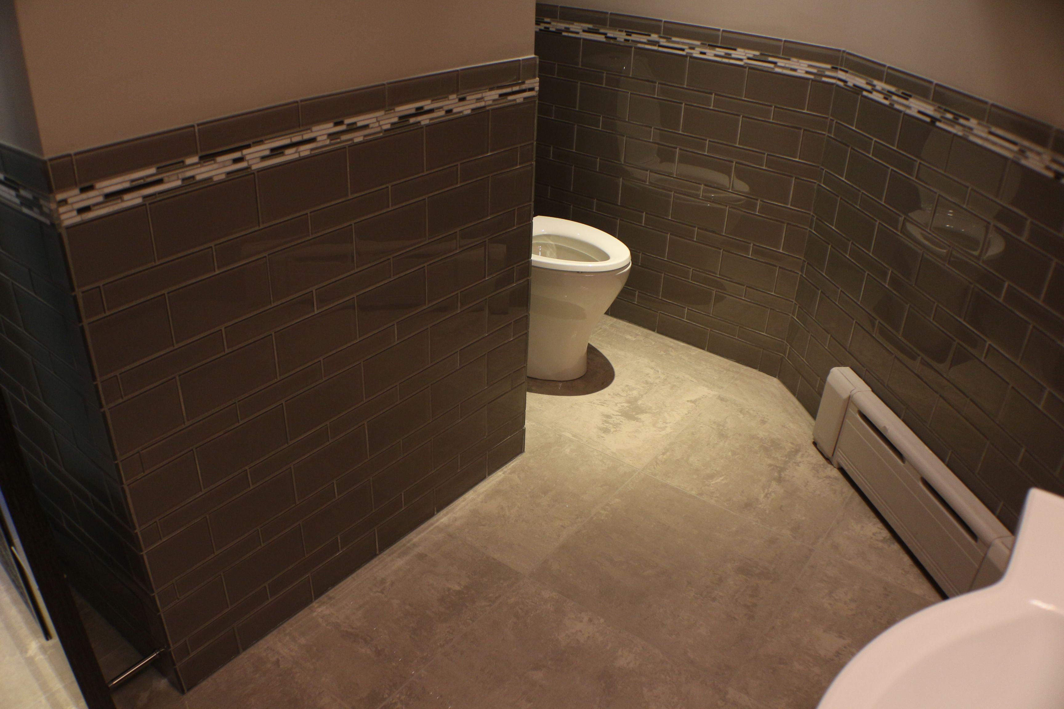 Unique bathroom design using a glass tile wainscoting customer