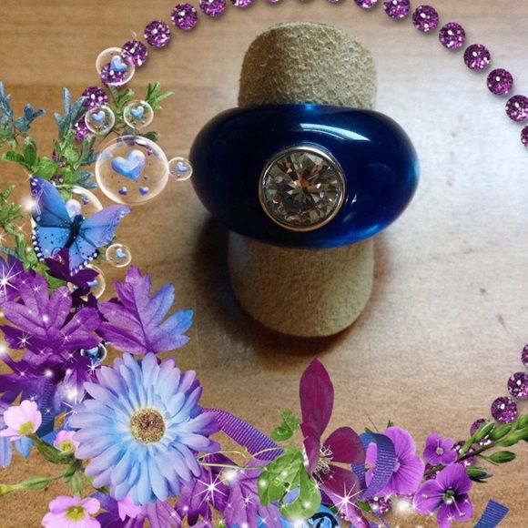 BON BON ring by Angelique de Paris. Brand new. A one and half carat brilliant cut bezel set cz in .925 sterling silver with platinum rhodium plating adds sparkle to the perfectly polished blue resin ring. Never worn. Gorgeous!!! Angelique de Paris Jewelry Rings