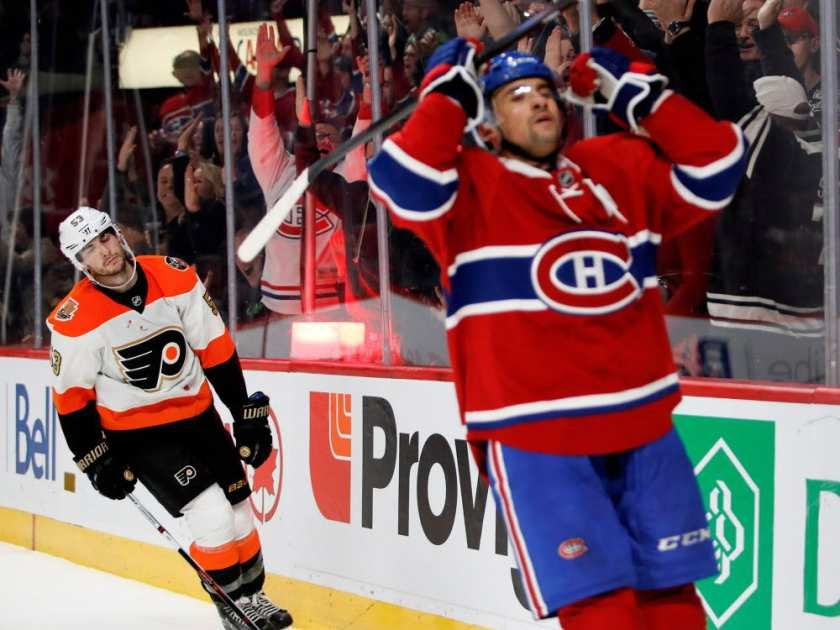 Philadelphia Flyers defenceman Shayne Gostisbehere is dejected as Canadiens centre Tomas Plekanec celebrates scoring a short- handed goal against Philadelphia Flyers goalie Michal Neuvirth during NHL action at the Bell Centre in Montreal on Saturday, Nov. 5, 2016.