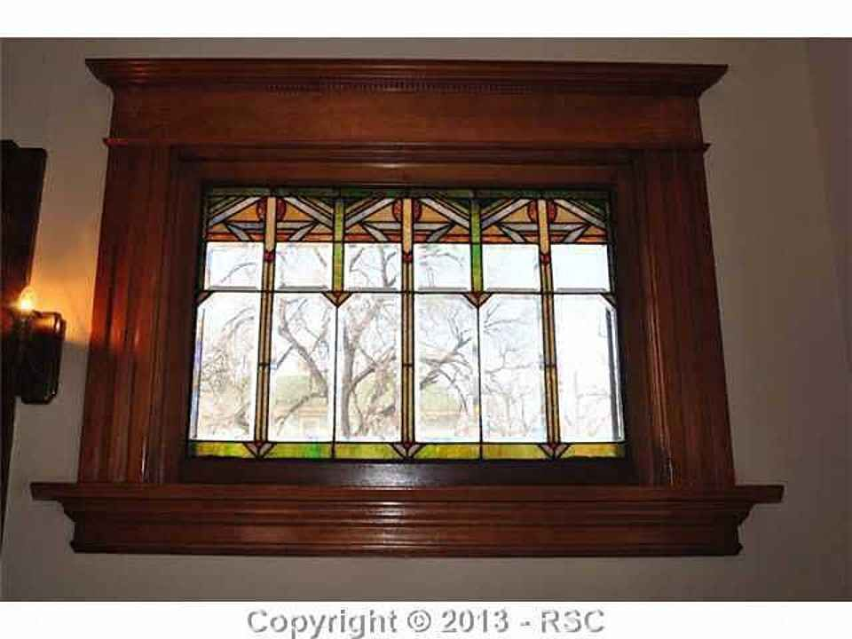 Arts & Crafts stained glass window in a 1914 house