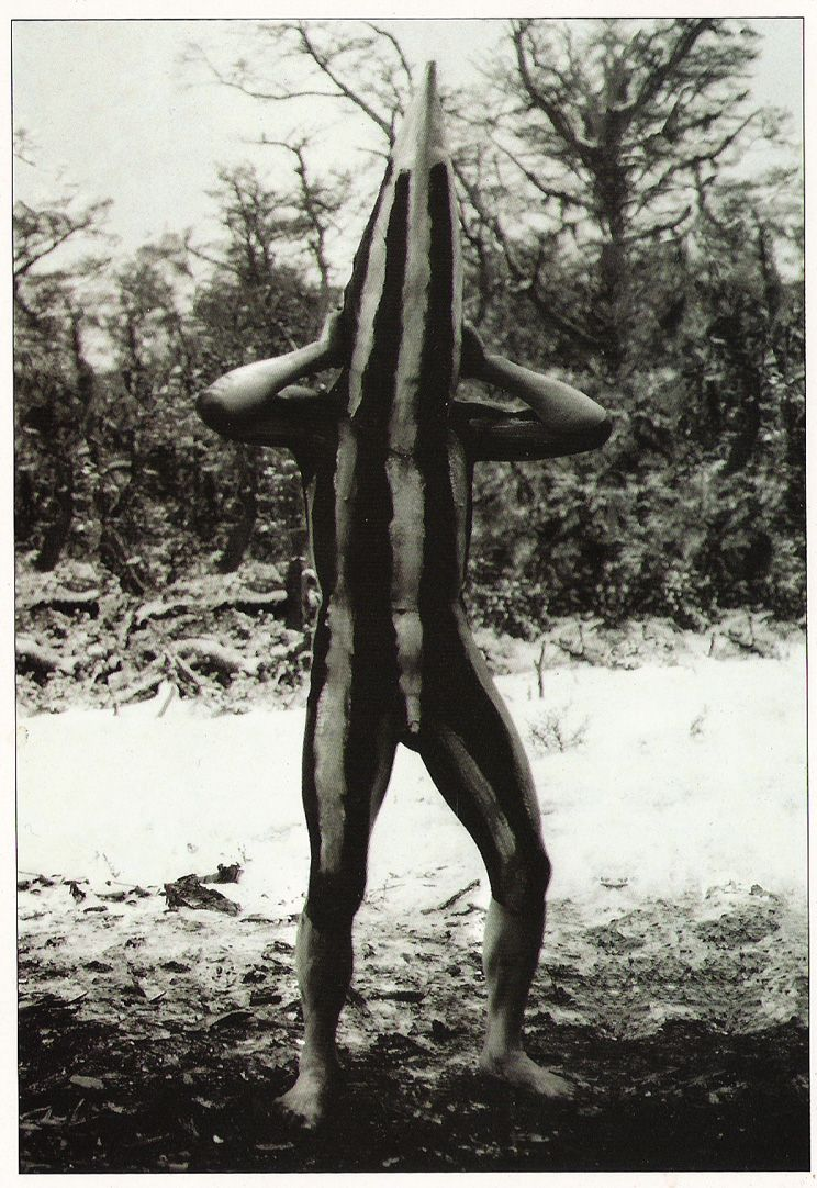 Kosménk, the spirit of Klóketen, part of an adolescent initiation ceremony. Selk'nam village (Onas).