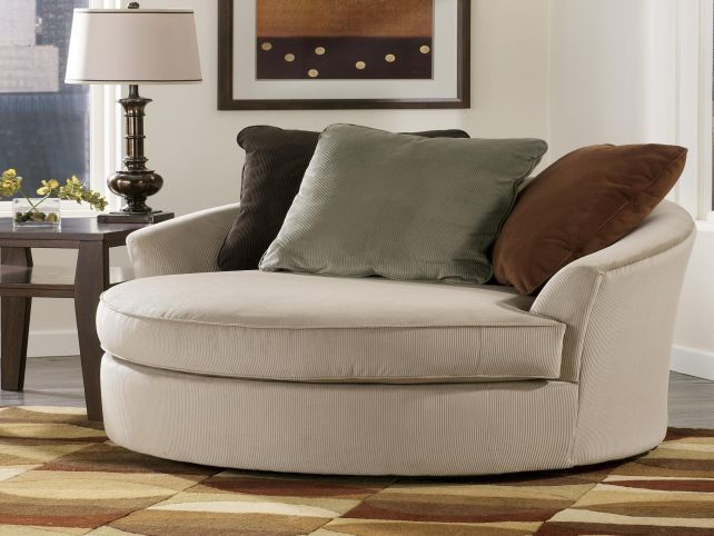 oval sofa simmons princeton ii bed reviews oversized lounge chair round swivel with cup holder