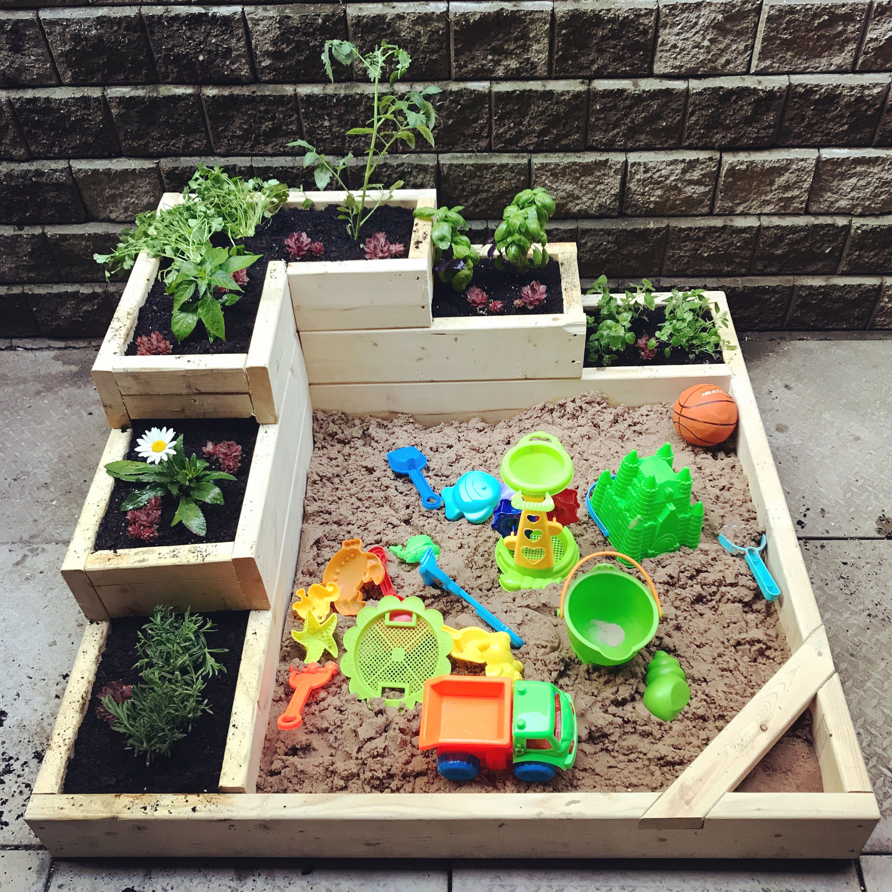 A #DIY sandbox garden that is perfect for kids to play in ...