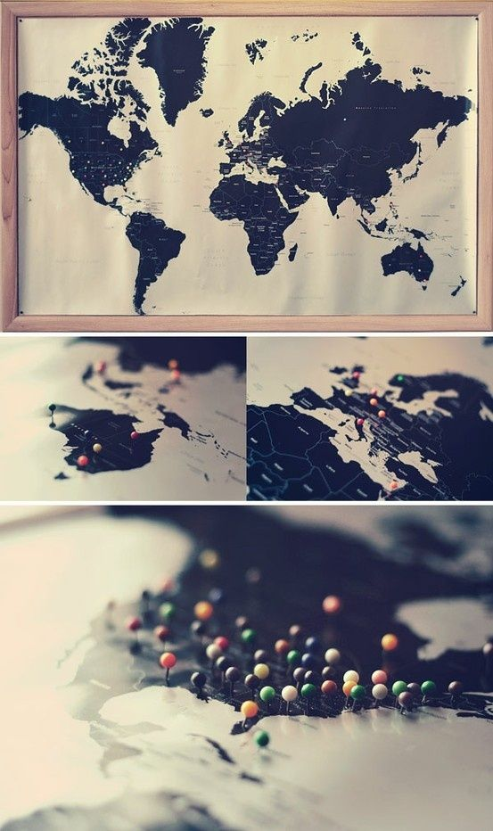 black map with colored pinspinned onto a cork board i would use tissue paper or colored tape or even parts of postcardsmaps from each place and cover