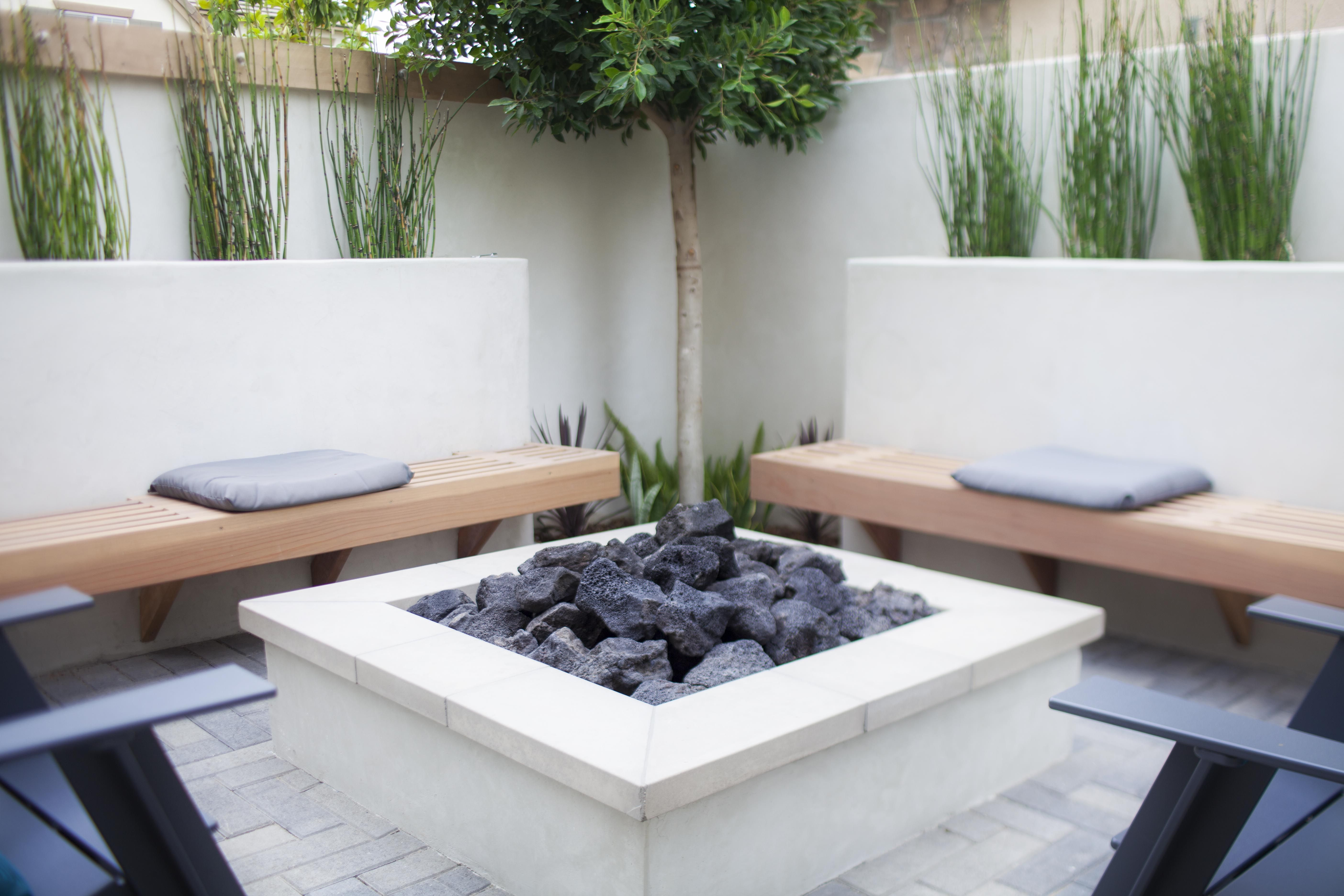 custom concrete firepit with benches and chairs to complete the