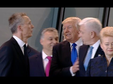 President Donald Trump pushes his way to the front of other NATO leaders while at the NATO summit in Brussels.