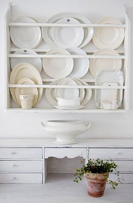 whitish platters on a great shelf unit