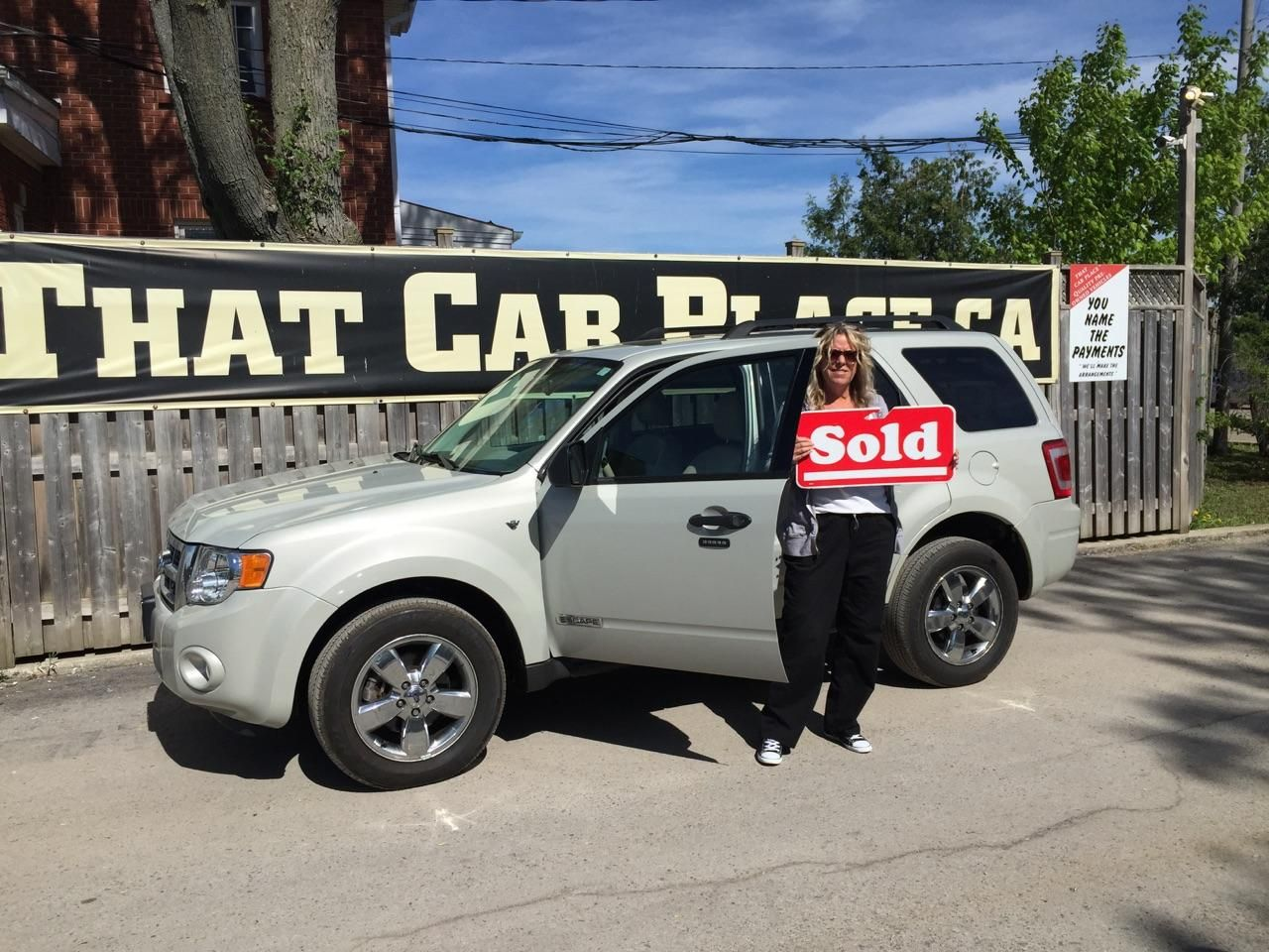 Happy customer lisa clough picking up her 2008 ford escape from that car place