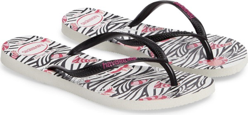 46e004ff91eb Havaianas Slim Millennial Disney Thematic Flip Flop in Pink. A graphic  print featuring your favorite Disney characters patterns a comfortable flip- flop ...
