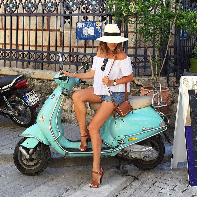 Summer style with tan leather sandals, Coach crossbody bag, panama hat, off-shoulder white top and jean shorts