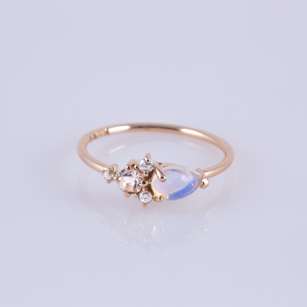 -solid 14kt gold -6x4mm natural pear cut Australian opal (AA grade) prong set -1 piece 3mm pink morganite prong set -2 pieces of 1.5mm white diamonds and 1 piec