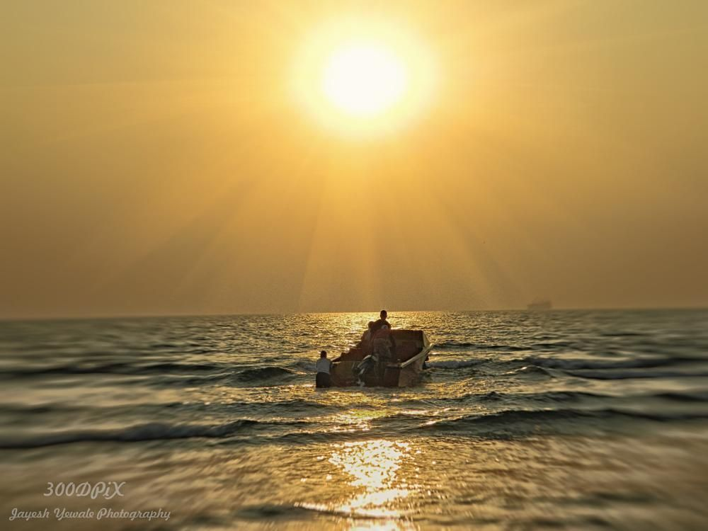 Sunset and boat by Jayesh Yewale
