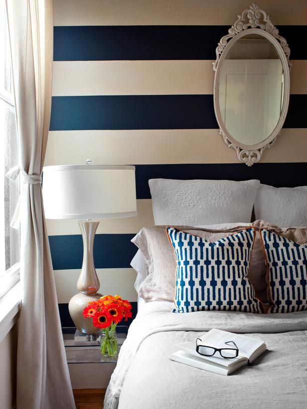 bold horizontal navy and white stripes wake up this bedroom thats tight on square