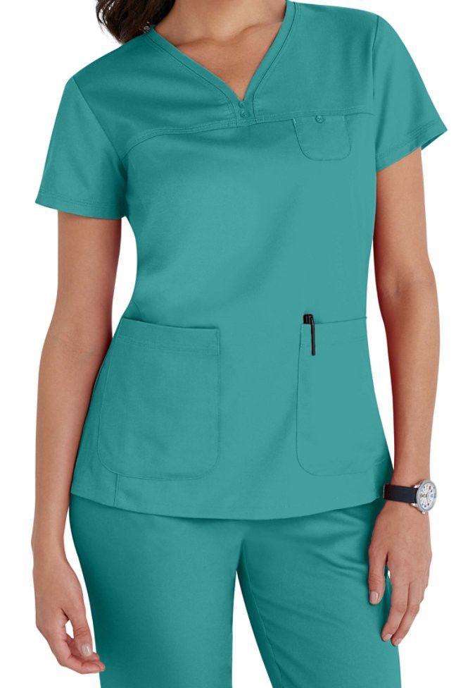 67845be17b9 Grey's Anatomy 3 Pocket V Neck Tonal Stitch Scrub Top - Teal 3 Pocket V Neck  Yoke Top With Side Panels And Tonal Stitching Detail.