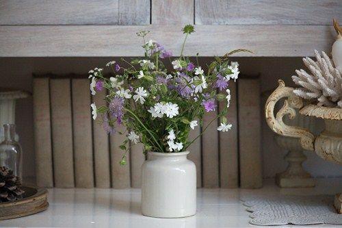 Wild spring flowers in an earthenware pot