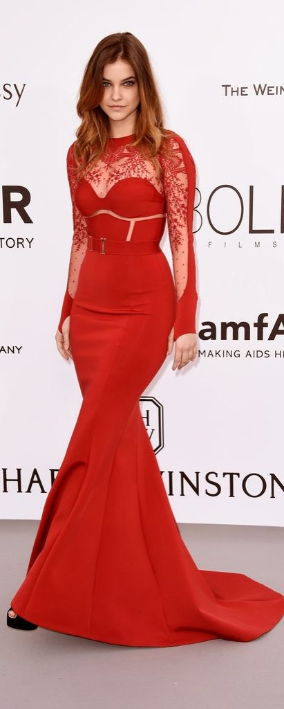 Barbara Palvin sizzled in this skintight red dress with lace sleeves at the amFar cannes gala
