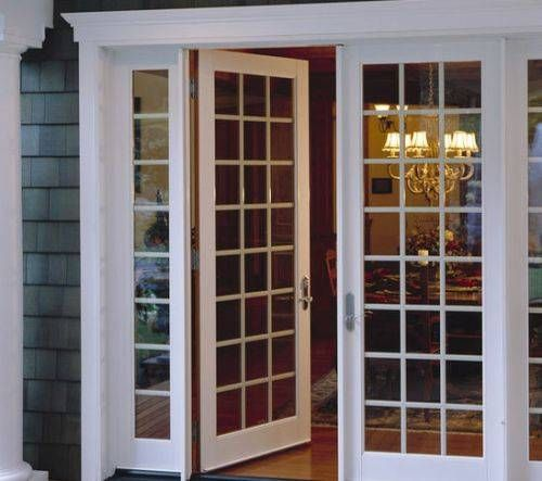 Pella Scenescape Ten Foot Tall Multi Slide Pocket Door Brings The Ultimate View For This Newly Constructed Home Patio Doors Barn Door Custom Patio Doors