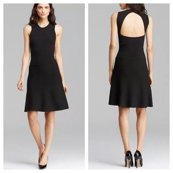 """Theory Maysen Sleeveless Back Cutout Knit Dress This little black dress from Theory is sure to become a wardrobe go-to.   Crafted from a flattering mid-weight knit fabric the simple shape of this piece is enhanced with the triangular cutout section on the back showing off a hint of skin in modest yet modern combination.  Black Knitted Round neck with rib-knit at collar Sleeveless Fitted with flared hem Triangular cutout back Approximately 37"""" in length 90% Viscose, 10% Polyester Theory…"""