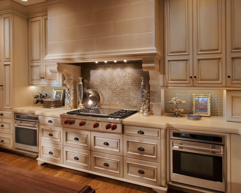 European Inspired Kitchen. Wolf cooktop. Custom stone hood