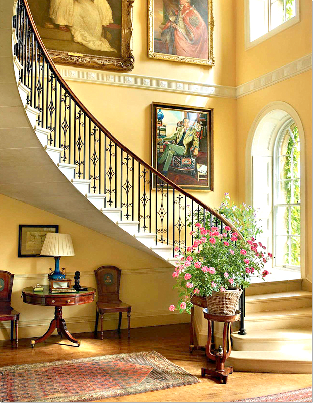 Elegant Traditional Foyer With Sweeping Staircase Yellow