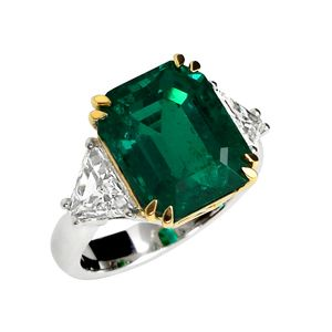 Eight Carat Colombian Emerald and Diamond Three Stone Engagement Ring