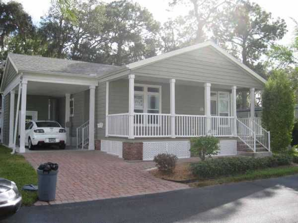 Carports Attached To Palm Harbor Manufactured Homes 30 X 48 2 Bedrooms 2 Bathrooms Color Grey Lot Re Manufactured Home Porch Remodel Mobile Home Renovations