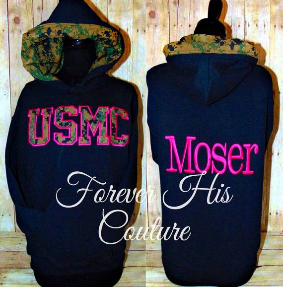 Official USMC Hobbyist License #31406    Support your Marine with our Varsity style pullover USMC- Camo lined hood with your Heros name on the