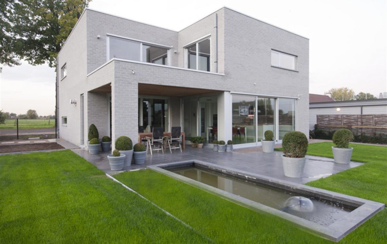 Maison moderne à ossature en bois - Jardin - Constructions Dewaele ...