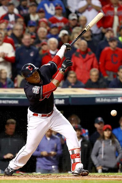Jose Ramirez of the Cleveland Indians hits a infield single to score a run in the first inning against the Chicago Cubs in Game One of the 2016 World...