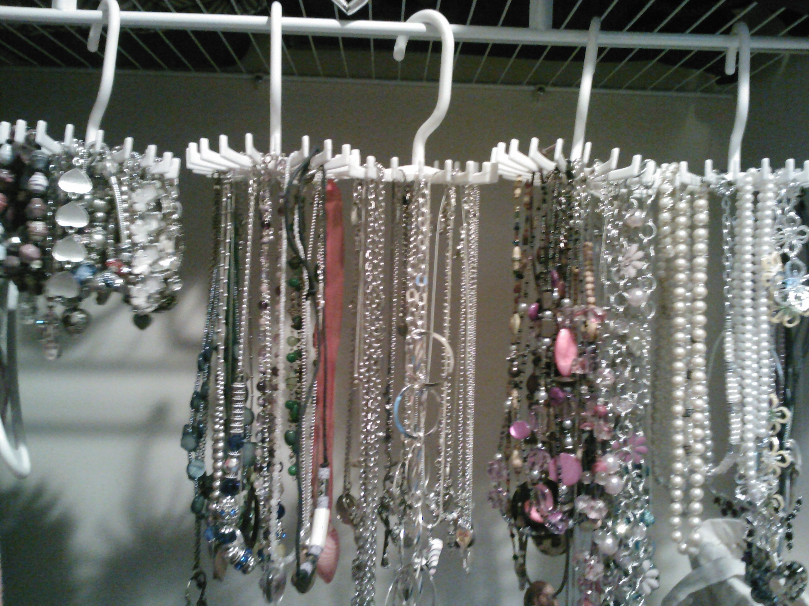 Use dollar store tie holders and organize your long necklaces in the closet