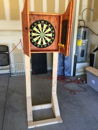 Over A Year Ago I Made A Very Cool Dartboard Cabinet When I Moved From New York To Arizona I Woun Dartboard Stand Diy Dart Board Cabinet Dart Board