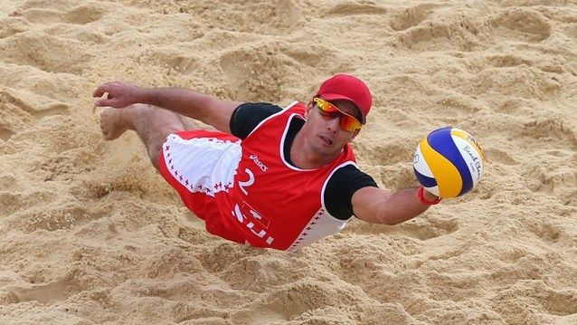 Jefferson #Bellaguarda dives for the ball  Jefferson Bellaguarda of Switzerland dives for the ball during his men's Beach Volleyball preliminary match against Brazil