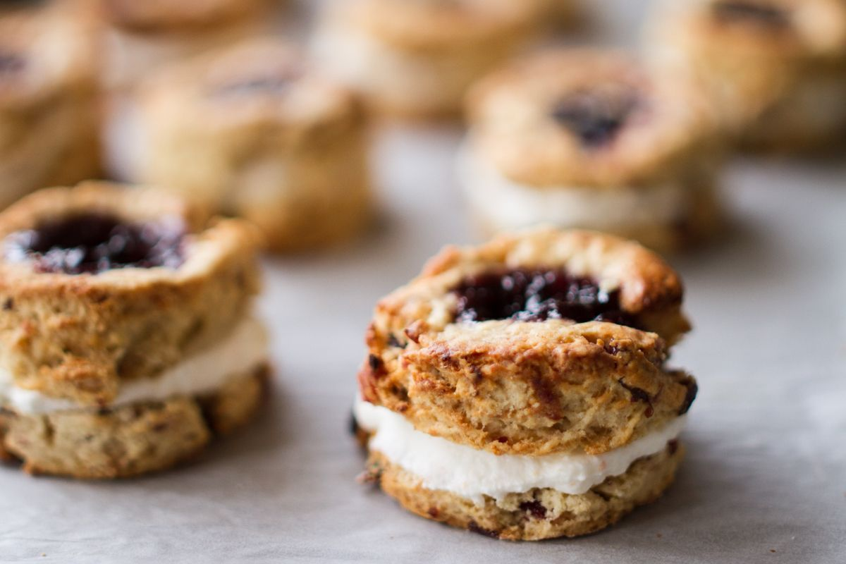 Strawberry Jelly Scones. For the scones:   Preheat oven to 200* C (390* F) Fan. Put the mandarin zest in a food processor and set aside. Simmer the mandarin juice and cloves for 2-3 minutes in a...