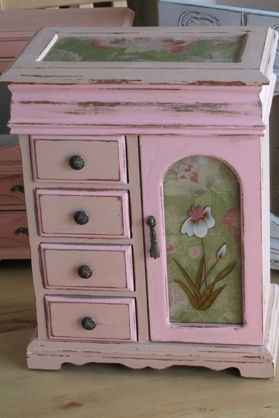$125.00.   This extra large jewelry box has a compartment with mirror on top, a necklace/bracelet carousel, and four drawers lined in a deep rose velveteen. This beautiful box has been hand painted in two shades of rose petal colours, and decoupage with a French style vintage wallpaper design. Sanded perfectly and a hand rubbed wax finish for many years of enjoyment!  This Beauty measures 12 Tall x 9.5 Wide x 5.5 Deep