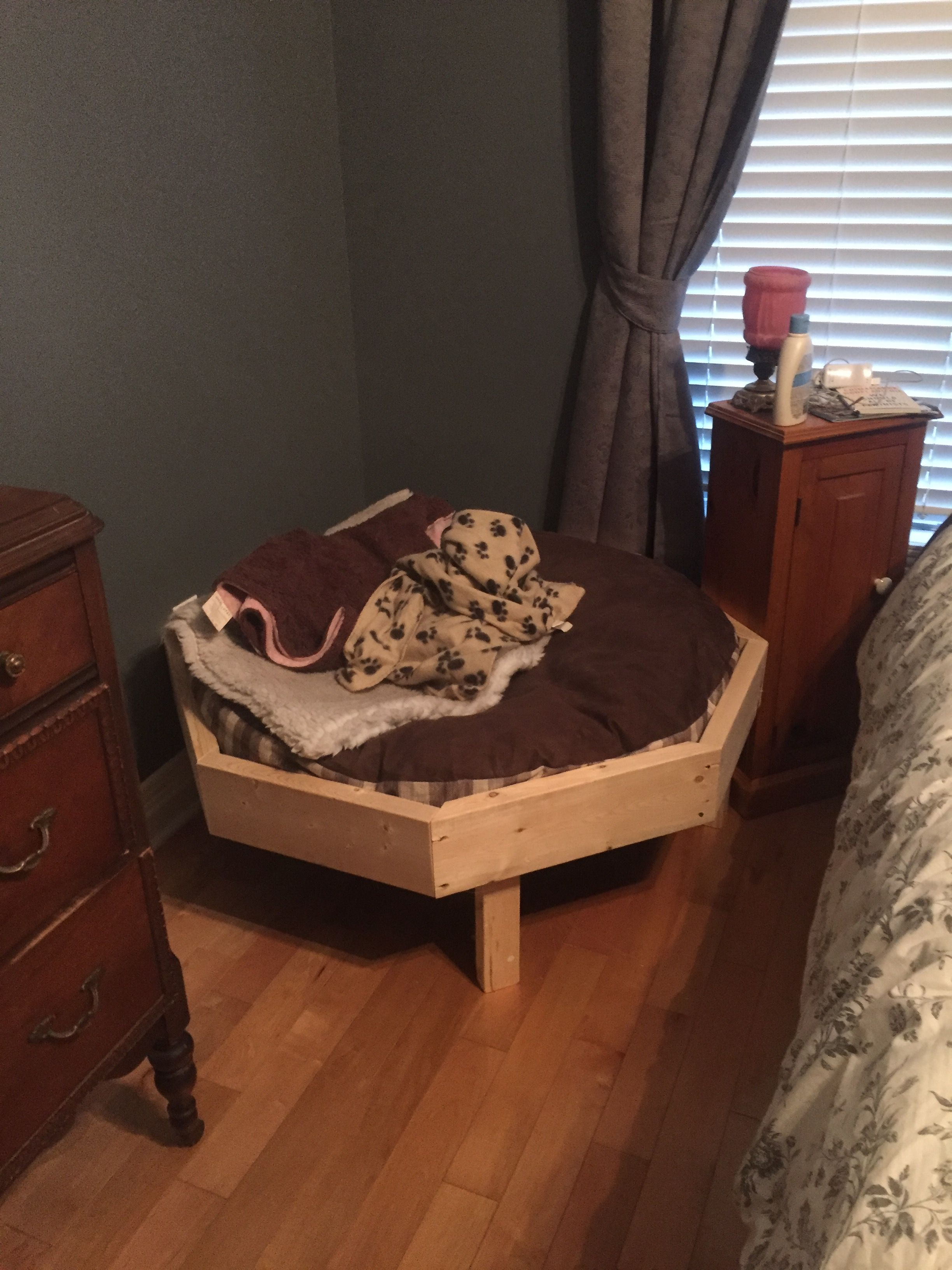 Octagonal raised dog bed. Used lawn chair webbing for the bottom