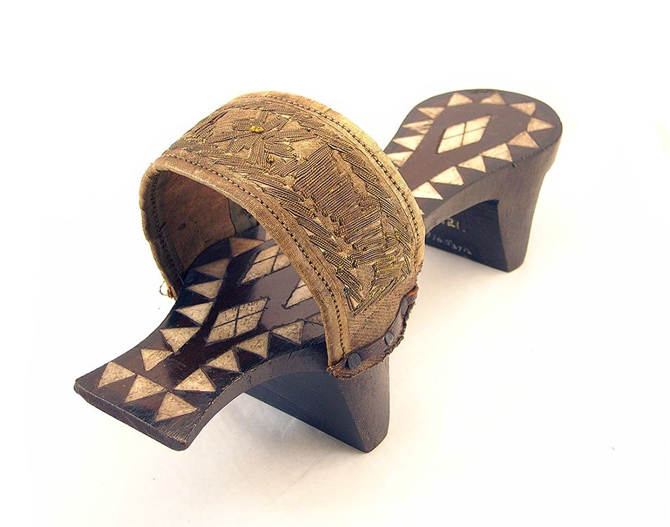 Kabkab (a raised wooden bath clog or sandal) were worn by women in bath houses to protect feet from heated and wet tiled floors. This decorative example (1858), thought to be from Damascus in Syria, has inlaid ivory or bone decoration, and a silk strap across top with metal embroidery. #100Objects #CumingMuseum