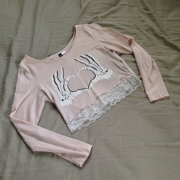 Pink Skeleton Crop Top Pink and white skeleton hands crop top from H&M. Very stretchy and can fit a small or medium. In great condition. No stains, no damage to the lace, no cracks in the print, etc. kawaii, rave, fairy kei, pastel goth, japanese, cosplay, festival, halloween, skeleton, skull, pink, hot topic, dollskill, unif, wildfox Tops Crop Tops