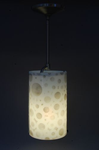 This fused glass pendant could be an beautiful and stylish touch to your home's interior design