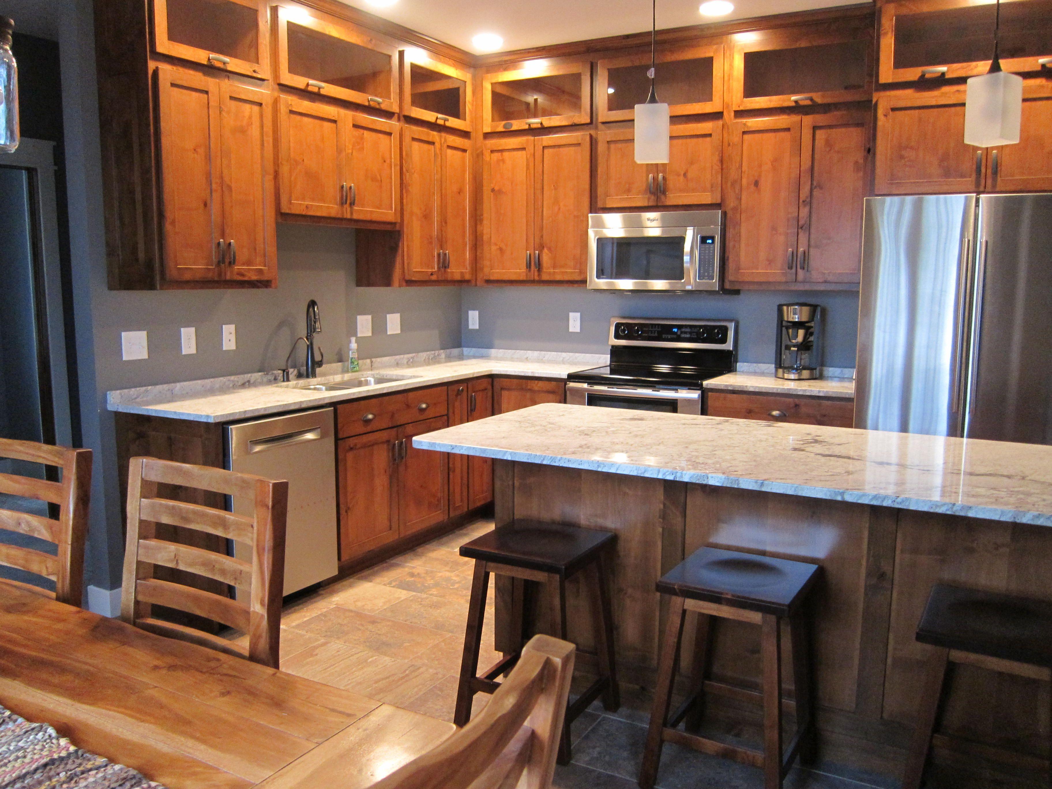 Kitchen rustic alder cabinets Snowflake granite