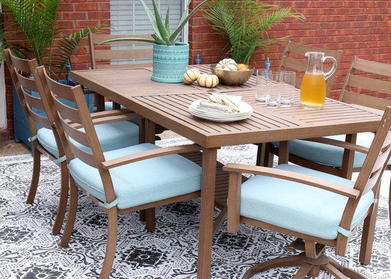 DIY Stenciled Concrete Rug | Diy concrete patio, Stencil ...