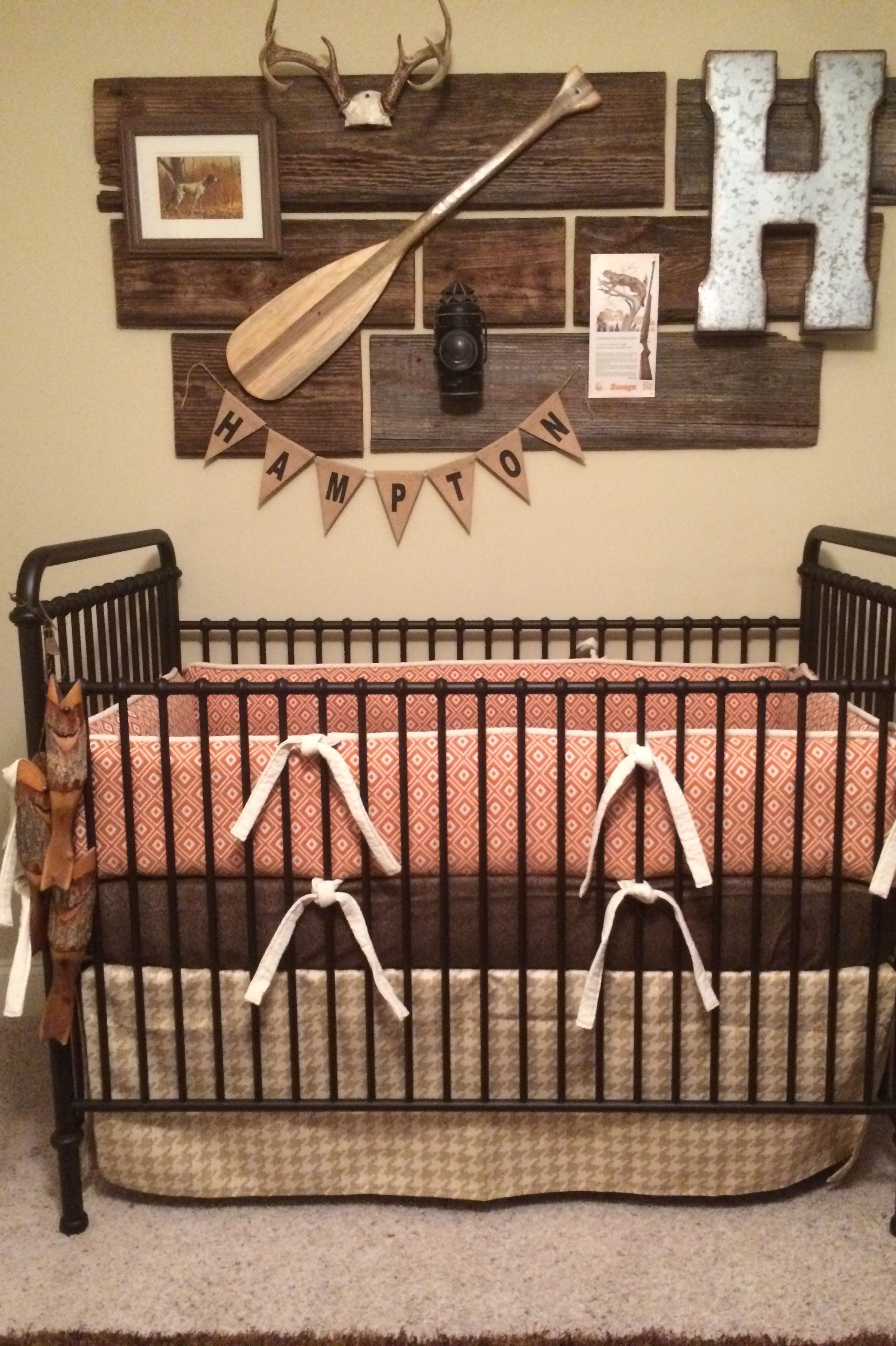 Orange Diamond Crib Bedding In A Rustic Nursery