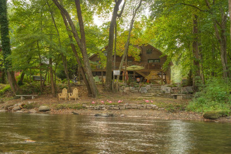 it rent runs thru cabin rustic rentals goldmine a helen romantic bedroom for ga home luxury rental river in cabins pin