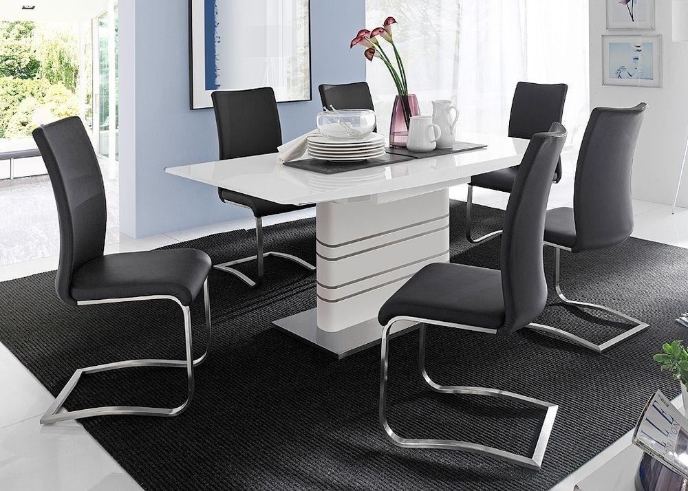 Esstisch Modusa mit Stühlen Arcos 5786. Buy now at https://www.moebel-wohnbar.de/essgruppe-esstisch-weiss-modusa-mit-stuehlen-arcos-schwarz-5786.html