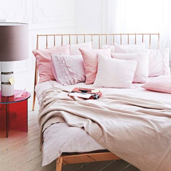 Modern Pale Pink Bedroom With Double Bed, Throws, Side Table And Bedside  Light