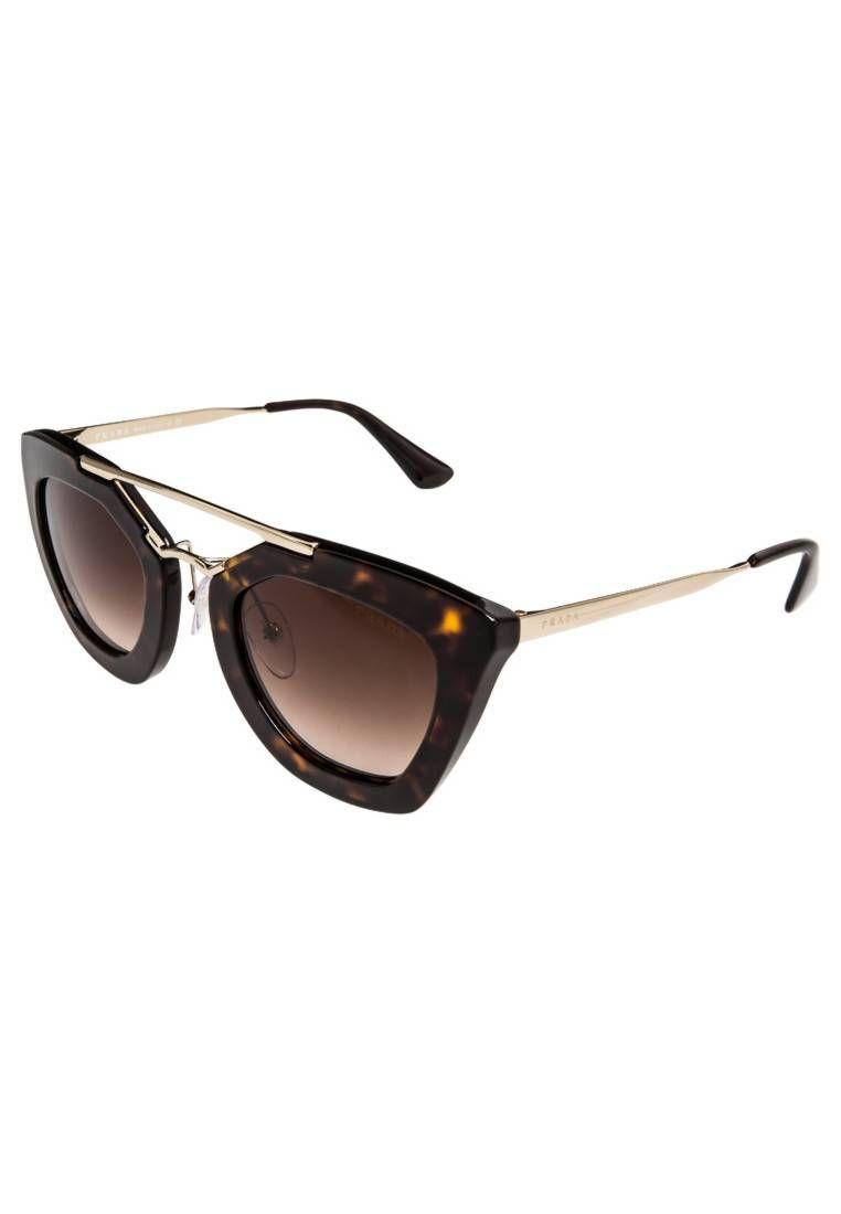 Prada. Lunettes de soleil - brown. Forme des lunettes style Wayfarer. Étui 74f03733c4d5